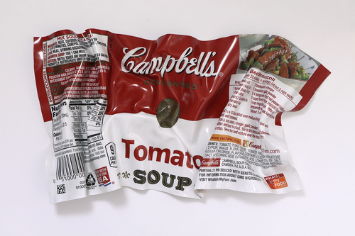 A flying Tomato Soup wrapper